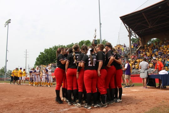 The Cardington softball team gathers to receive the Division III state runners-up trophy for the second straight year at Akron's Firestone Stadium. Warren Champion won the finale 5-0 Saturday morning.