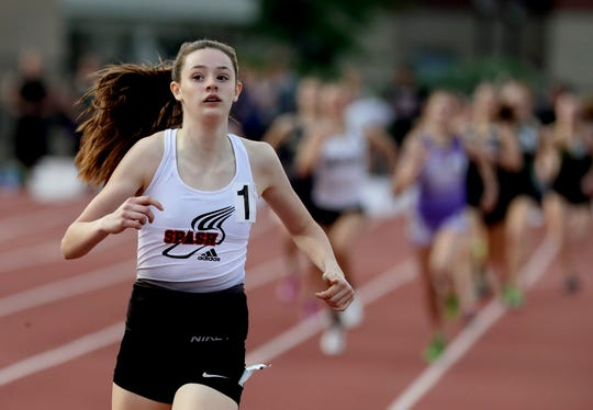 Stevens Point freshman Roisin Willis sets a girls Division 1 state record in the 800 meters with a time of 2:05.68.