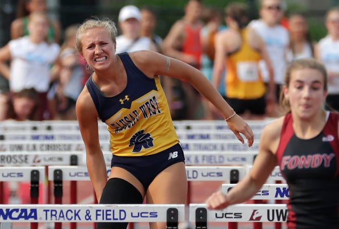 Wausau West's Brooke Jaworski, the state record holder in the girls Division 1 300 hurdles, aggravates a muscle injury in her right leg and fails to finish her qualifying heat of the 100 hurdles Friday.