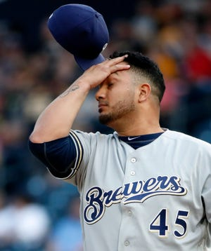 Brewers starting pitcher Jhoulys Chacin collects himself after giving up an RBI single to Josh Bell of the Pirates during the first inning Friday night. Things only got worse for Chacin a couple innings later.
