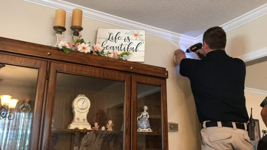 Lance Smithson with the West Monroe Fire Department installs a smoke detector in the home of Doris Thompson. The WMFD will professionally install a free smoke detector by request.