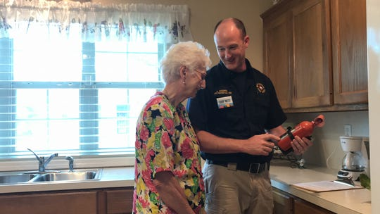 Charles Hugghins with the West Monroe Fire Department inspects Doris Thompson's home. During the inspection, Hugghins recommended the replacement of an older fire extinguishes and unplugging small appliances, such as a coffee maker, to reduce fire hazards.