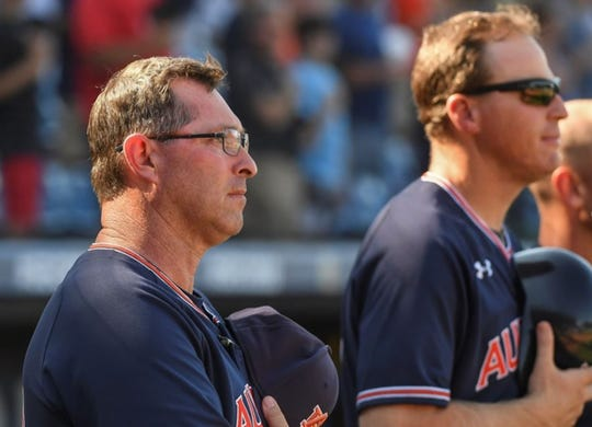 Butch Thompson during the national anthem before an SEC Tournament game on May 22, 2019, in Hoover, Ala.