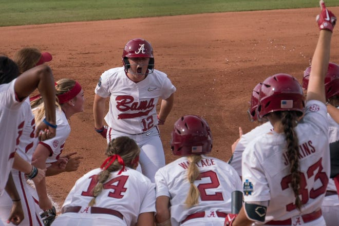 The Alabama softball team reacts after scoring a home run vs. Florida in the Women's College World Series on June 1, 2019.