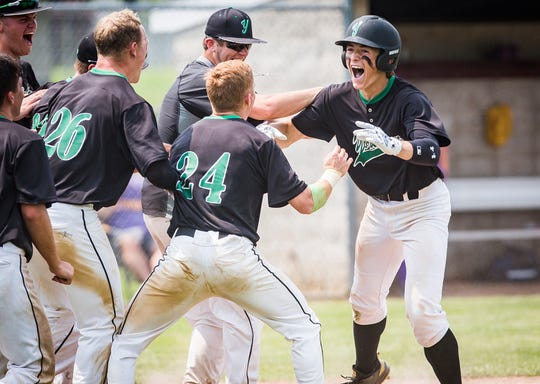 Yorktown's Parker Stinson celebrates a homerun against New Haven during their regional game at Garrett High School Saturday, June 1, 2019.