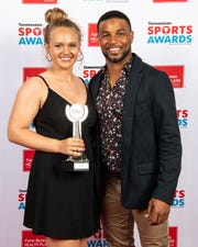 Softball player of the year Caitlyn McCrary with Golden Tate backstage at the Tennessean Sports Awards at Music City Center in Nashville, Tenn., Friday, May 31, 2019.