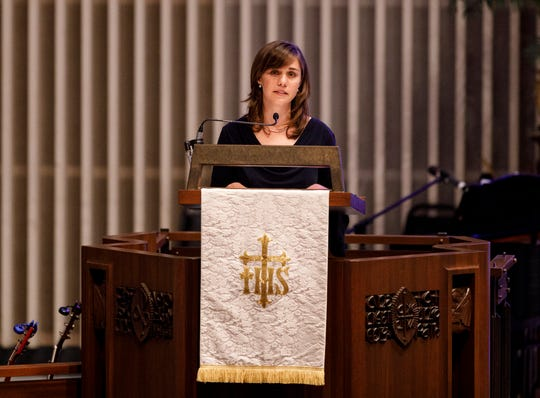 "Amanda Held Opelt gives a eulogy for her sister, author Rachel Held Evans, during her funeral at First-Centenary United Methodist Church on Saturday, June 1, 2019, in Chattanooga, Tenn. Evans was a Dayton, Tenn., resident who authored books including ""A Year of Biblical Womanhood,"" ""Searching for Sunday"" and ""Inspired: Slaying Giants, Walking on Water, and Loving the Bible Again."""