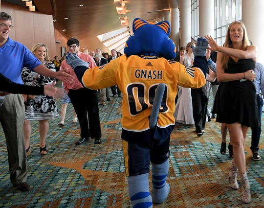 Predators mascot Gnash high-fives fans at the 4th annual Tennessean Sports Awards at the Music City Center in Nashville on May 31, 2019.