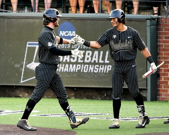 Vanderbilt first baseman Julian Infante (22) is congratulated after his solo home run in the bottom of the second against Ohio State during the NCAA Division I Baseball Regionals at Hawkins Field Friday, May 31, 2019, in Nashville, Tenn.