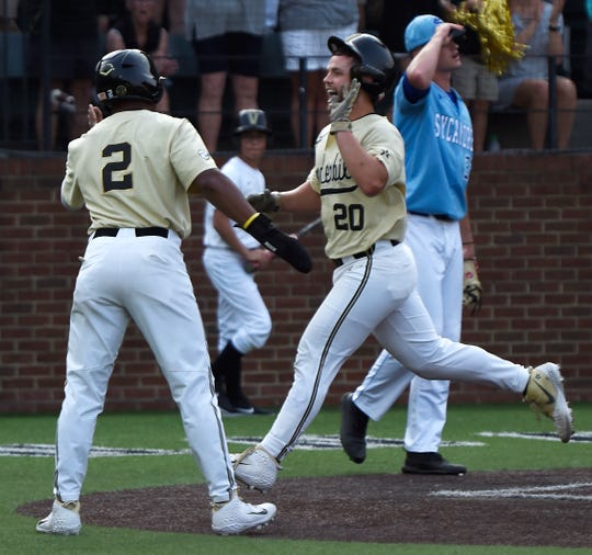 Vanderbilt second baseman Harrison Ray (2) and designated hitter Ty Duvall (20) score in the second inning to make it 3-1 over Indiana State during the NCAA Division I Baseball Regionals at Hawkins Field Saturday, June 1, 2019, in Nashville, Tenn.