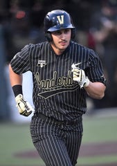 Vanderbilt right fielder JJ Bleday (51) takes a base after walking in the fifth inning against Ohio State during the NCAA Division I Baseball Regionals at Hawkins Field Friday, May 31, 2019, in Nashville, Tenn.