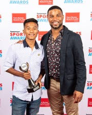 Boys soccer player of the year Nawn Thang with Golden Tate backstage at the Tennessean Sports Awards at Music City Center in Nashville, Tenn., Friday, May 31, 2019.
