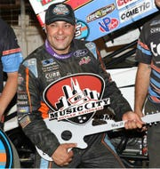 Donny Schatz shows off the guitar trophy he won Friday night after claiming the opening night victory in the Music City Outlaw Nationals at Farigrounds Speedway Nashville.
