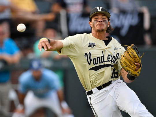 Vanderbilt third baseman Austin Martin (16) makes a throw to first base to end the second inning against Indiana State during the NCAA Division I Baseball Regionals at Hawkins Field Saturday, June 1, 2019, in Nashville, Tenn.