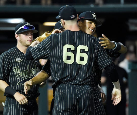 Vanderbilt pitcher Drake Fellows (66) is congratulated after his win over Ohio State during the Nashville Regionals.