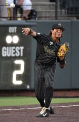 Vanderbilt third baseman Austin Martin makes a throw to first base May 31, 2019, in Nashville.