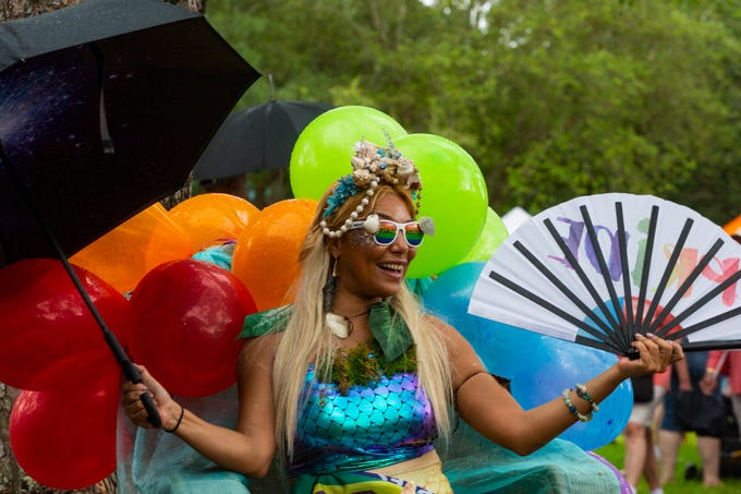 """Ynda Schulberg also known as """"Yemaya the Mermaid"""" of Naples poses for pictures and greets guest during the annual Naples Pride Festival, Saturday, June 1, 2019 at Cambier Park in Naples."""