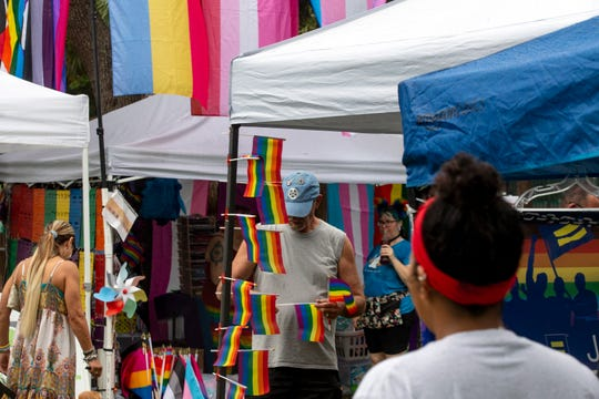 Naples Pride Festival goers visit vendors  participating in this year's Naples Pride Festival, Saturday, June 1, 2019 at Cambier Park in Naples.