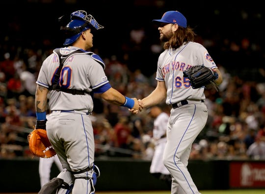 New York Mets relief pitcher Robert Gsellman (65) celebrates with catcher Wilson Ramos after a game against the Arizona Diamondbacks, Friday, May 31, 2019, in Phoenix. The Mets won 5-4.
