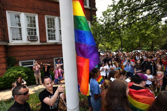 Brett Essenter, a founding member of the Rutherford Pride Alliance, raises a rainbow flag for LGBT pride at Rutherford Borough Hall on Saturday, June 1, 2019.