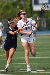 Ridgewood's Clare McCooe (25) carries the ball as Eastern's Tori Accardo (3) defends during the NJSIAA girls lacrosse Group 4 final at Kean University in Union on Saturday, June 1, 2019.