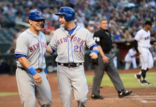 May 31, 2019; Phoenix, AZ, USA; New York Mets catcher Wilson Ramos (40) and New York Mets third baseman Todd Frazier (21) celebrate after scoring runs against the Arizona Diamondbacks during the second inning at Chase Field.