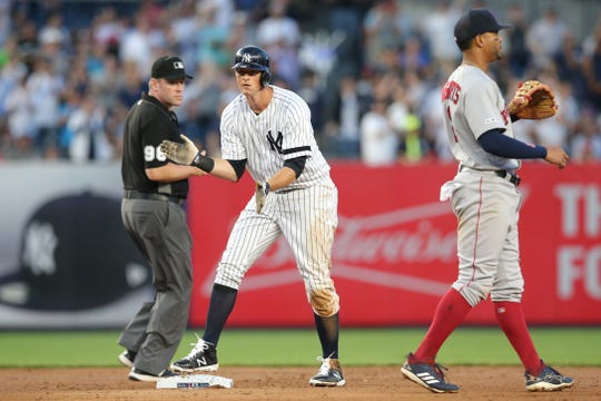 May 31, 2019; Bronx, NY, USA; New York Yankees second baseman DJ LeMahieu (26) reacts after hitting an RBI double against the Boston Red Sox during the third inning at Yankee Stadium.