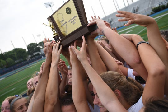 Ridgewood shows off its winning trophy after beating Eastern in the NJSIAA girls lacrosse Group 4 final at Kean University in Union on Saturday, June 1, 2019.