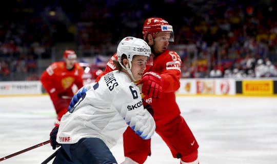 Yevgeni Dadonov #63 of Russia challenges Jack Hughes #6 of United States during the 2019 IIHF Ice Hockey World Championship Slovakia quarter final game between Russia and United States at Ondrej Nepela Arena on May 23, 2019 in Bratislava, Slovakia.