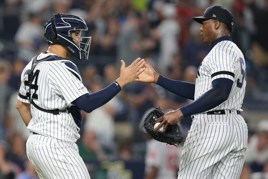 May 31, 2019; Bronx, NY, USA; New York Yankees relief pitcher Aroldis Chapman (54) and Yankees catcher Gary Sanchez (24) celebrate after defeating the Boston Red Sox at Yankee Stadium.