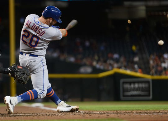 May 31, 2019; Phoenix, AZ, USA; New York Mets first baseman Pete Alonso (20) hits a single against the Arizona Diamondbacks during the third inning at Chase Field.