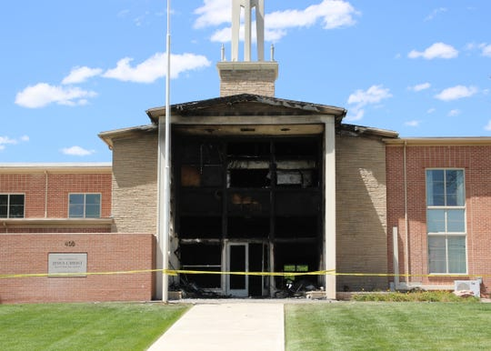 Officials investigate a fire on Saturday, June 1, 2019, that burned The Church of Jesus Christ of Latter-day Saints, 400 W. Apache St., in Farmington.