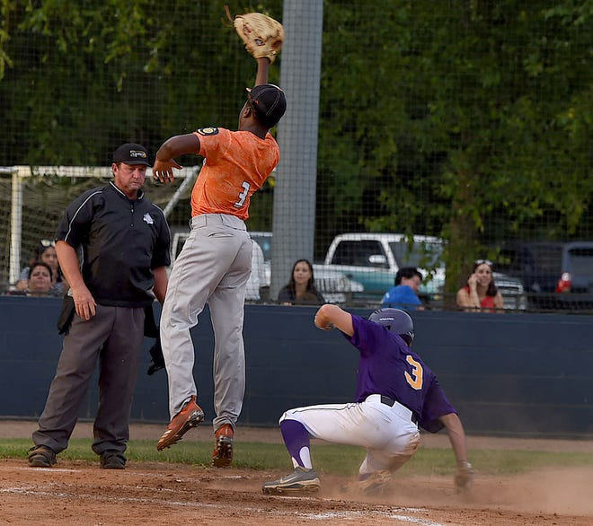 St. Landry Bank Indians' Colton Jacobs slides across home plate Thursday night during the Indians' American Legion Baseball game with the Warriors