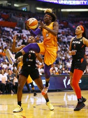 Phoenix Mercury forward Essence Carson drives to the basket and scores against the Las Vegas Aces in the first half during the home opener on May 31, 2019 in Phoenix, Ariz.