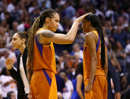 Phoenix Mercury Brittney Griner pats DeWanna Bonner on the head after beating the Las Vegas Aces during the home opener on May 31, 2019 in Phoenix, Ariz.
