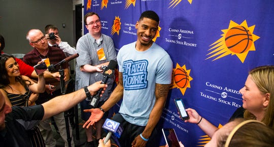 Charles Matthews, a guard from the University of Michigan, speaks to the press after working out for the Phoenix Suns at Talking Stick Resort Arena in Phoenix, Friday,