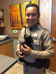 DPS Trooper Montes holds a kitten that was rescued by a passerby after it was thrown from a moving vehicle on U.S. 60 in Mesa earlier this week.