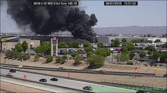 A fire on the south side of Interstate 10 near 51st Avenue in Phoenix was sparked by a stack of railroad ties Saturday, fire officials said.