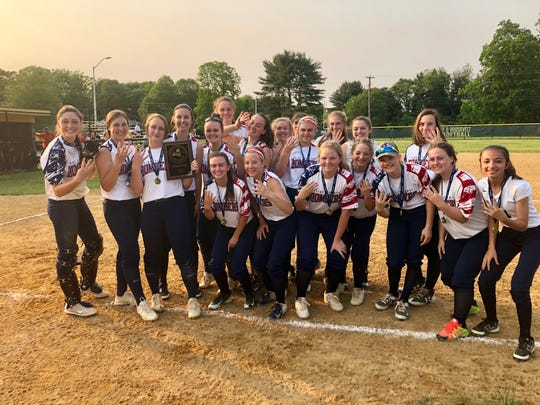 The Pine Plains softball team poses holding up four fingers after capturing their fourth straight Section 9 Class C title.