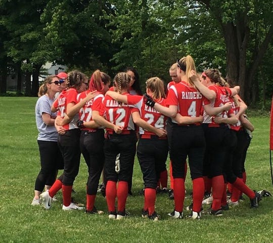 The Red Hook softball team huddles before its Section 9 Class A final against Minisink Valley on Saturday.