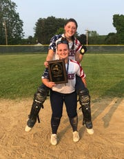 Pine Plains' Meg Murray gives teammate Haley Strang a piggyback ride as the two celebrate after Pine Plains beat S.S. Seward to win the Section 9 Class C softball title on Friday.