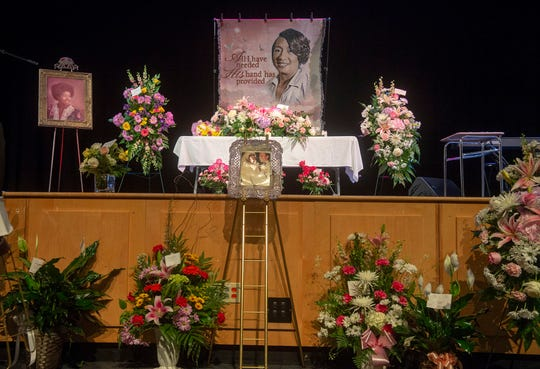 "A photo from her wedding sits among the nearly 60 floral arrangements before the celebration of life for Virginia ""Chris"" Shockley on Saturday, June 1, 2019. She was married to Mario ""Butch"" Shockley for nearly 43 years. The couple met at William Penn Sr. High School, where the celebration was held, and where she worked for the past 15 years."