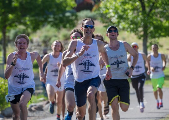 Dominic Henriques leads the Prominence Health Plan team to the 2019 Reno Tahoe Odyssey finish at Idlewild Park in Reno on Saturday. The team finished in 16 hours, 54 minutes and 10 seconds.