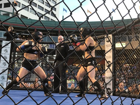 Niki Cruz, left, and Jessica Locke fight  Friday night at Greater Nevada Field in Reno.