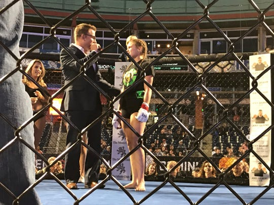 Kelly McKay talks to the ring announcer after her win Friday.