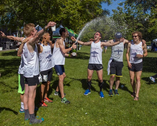 The Prominence Health Plan team celebrates after their record setting run during the 2019 Reno Tahoe Odyssey at Idlewild Park in Reno on Saturday.