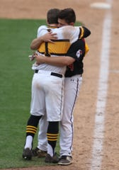 McQuaid's Tyler Griggs finds Penfield's Bobby Bradley, while McQuaid celebrates its win over Penfield, and hugs Bradley.  The two went to preschool together and played in Little League together.  They both are graduating from their respective schools.