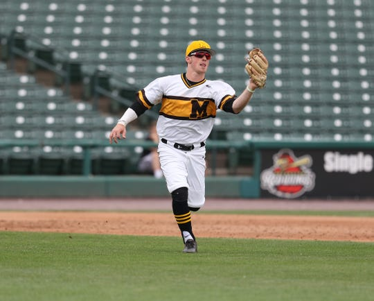 McQuaid's Tyler Griggs makes a play in the infield for an out.
