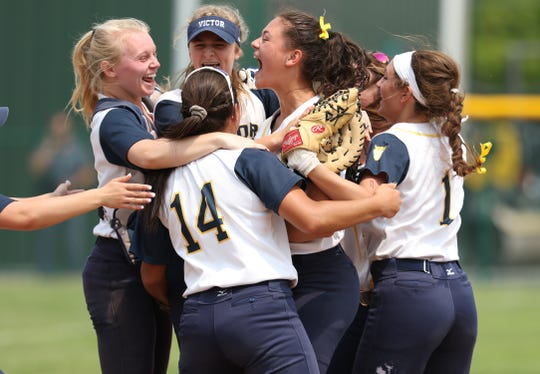 Victor celebrates its 1-0 victory over Fairport in the Section V Class AA Softball championship game held at The College at Brockport on June 1, 2019.