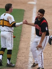 McQuaid's Tyler Griggs after hugging Penfield's Bobby Bradley after McQuaid's win, handshakes with him.  Bradley was the final out.  The two have known each other since preschool and played little league together.